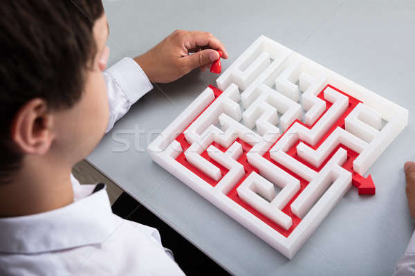 Businessman solving maze Stock photo © AndreyPopov