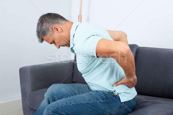 Volwassen man lijden rugpijn vergadering sofa mannen Stockfoto © AndreyPopov