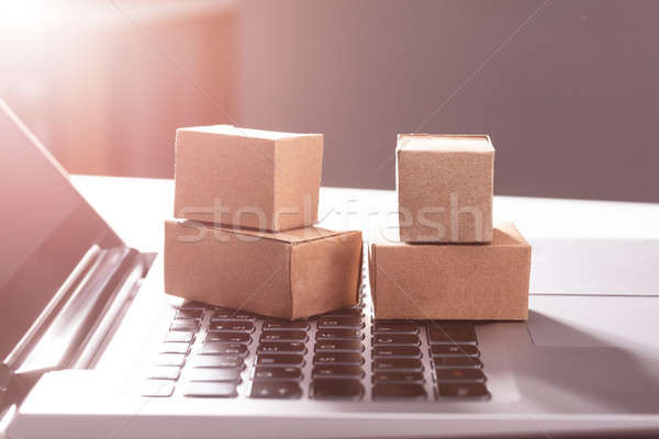 Cardboard Boxes On Laptop Keypad Stock photo © AndreyPopov
