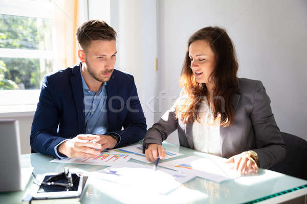 Two Businesspeople Analyzing Graph Stock photo © AndreyPopov