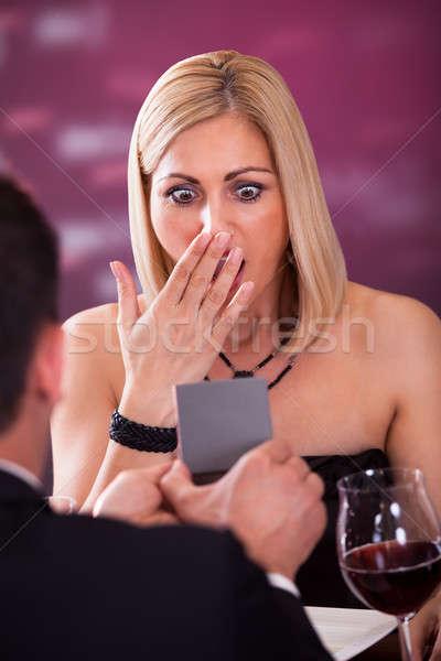 Meglepődött nő étterem néz jegygyűrű család Stock fotó © AndreyPopov