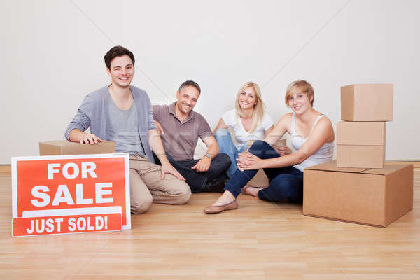 Happy family packing up their home Stock photo © AndreyPopov
