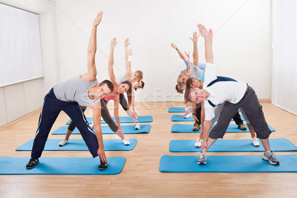 Pilates class exercising in a gym Stock photo © AndreyPopov