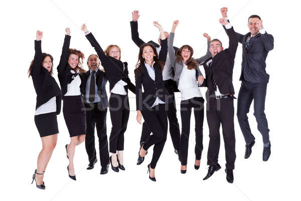 Group of jubilant business people Foto stock © AndreyPopov