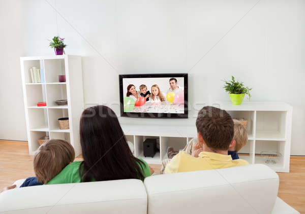Young family watching TV Stock photo © AndreyPopov