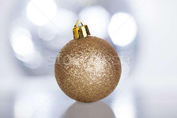 Złoty dekoracyjny christmas cacko świetle Zdjęcia stock © AndreyPopov