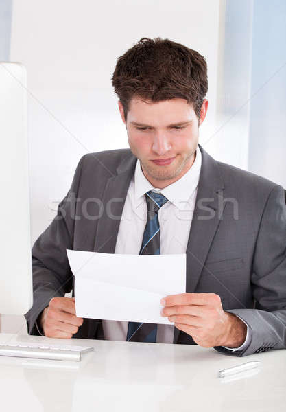 Businessman Holding Paper Stock photo © AndreyPopov