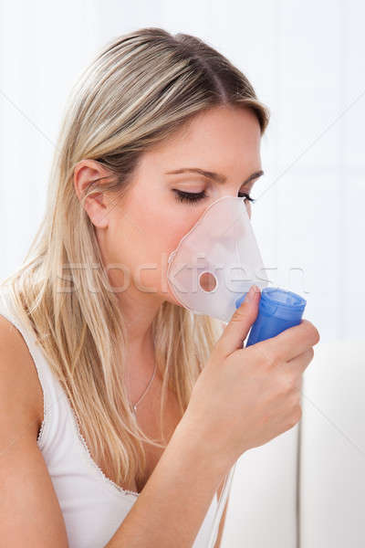 Woman with asthma inhaler Stock photo © AndreyPopov