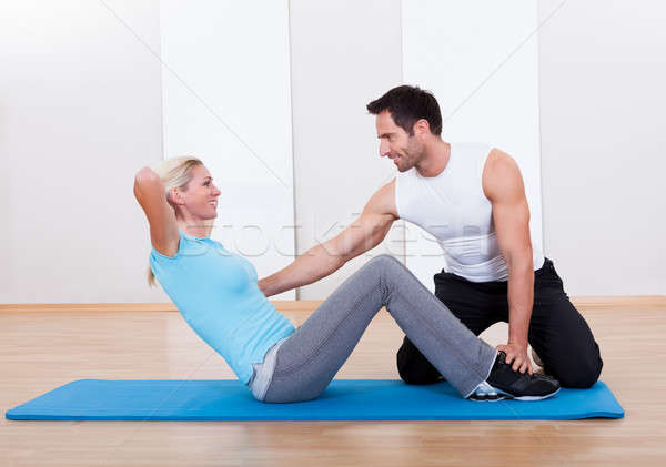 Fitness instructor teaching sit ups Stock photo © AndreyPopov