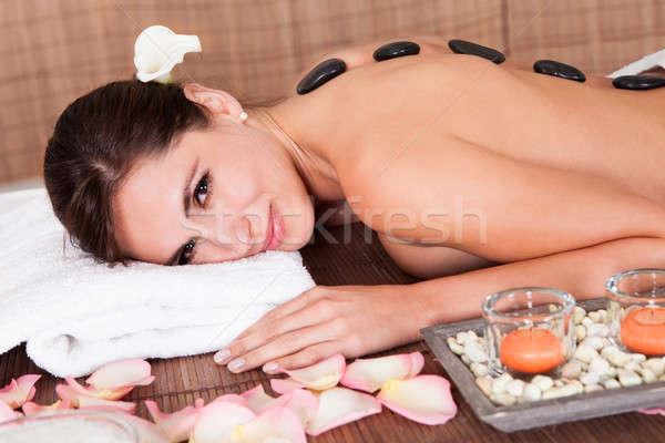 Güzel genç kadın sıcak taş tedavi spa Stok fotoğraf © AndreyPopov