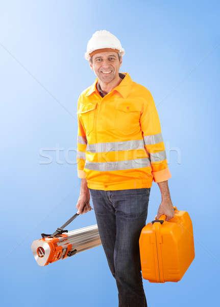 Stock photo: Senior land surveyor with theodolite equipment