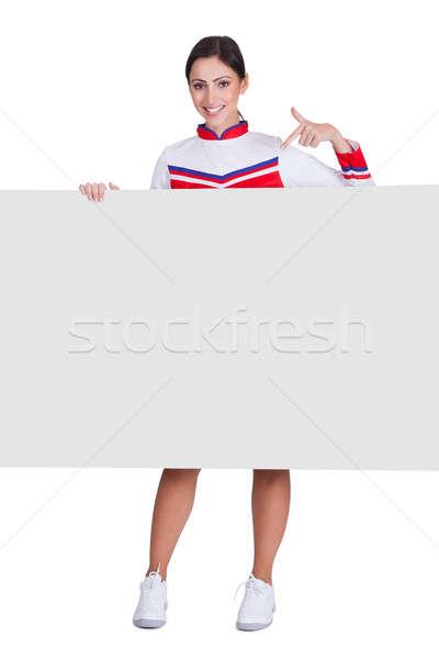 Cheerleader wijzend geïsoleerd witte vrouw Stockfoto © AndreyPopov