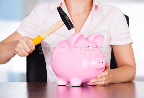 Woman With Piggybank And Hammer Stock photo © AndreyPopov