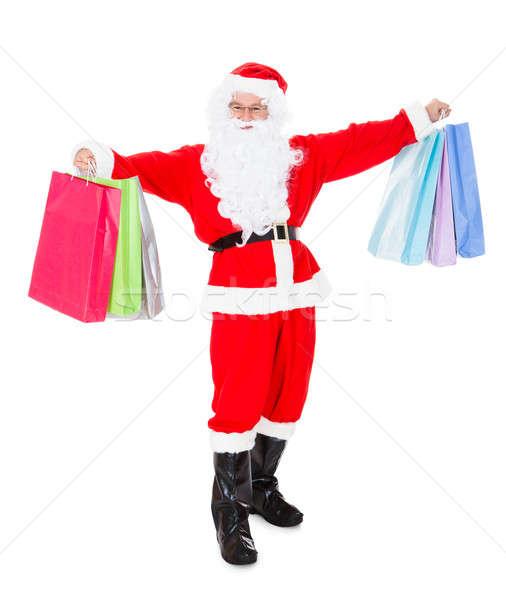 Portrait of santa holding shopping bag Stock photo © AndreyPopov