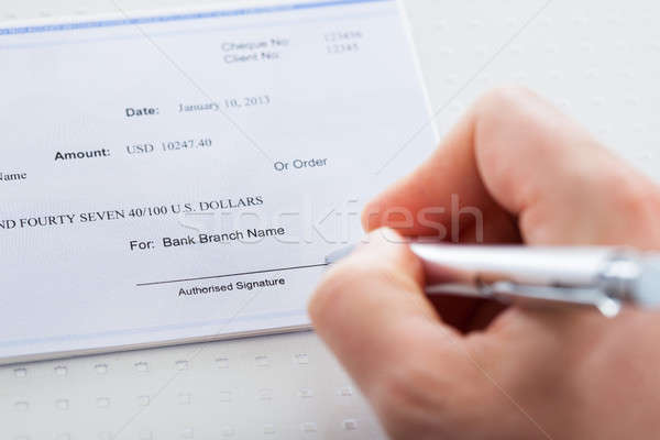 Hand With Pen Over Checkbook Stock photo © AndreyPopov