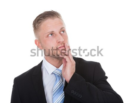 Businessman standing deep in thought Stock photo © AndreyPopov
