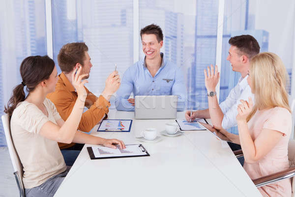 Colleagues Asking Question To Manager In Meeting Stock photo © AndreyPopov