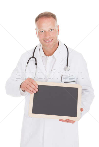 Smiling Male Doctor Holding Blank Slate Stock photo © AndreyPopov