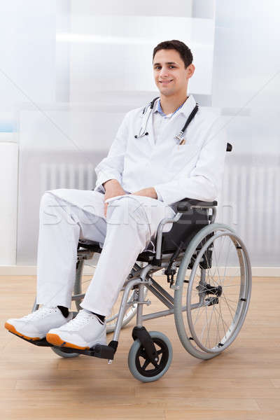 Handicapped Doctor Sitting On Wheel Chair In Hospital Stock photo © AndreyPopov