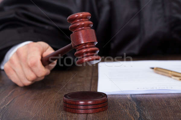 Judge Giving Verdict By Hitting Mallet Stock photo © AndreyPopov