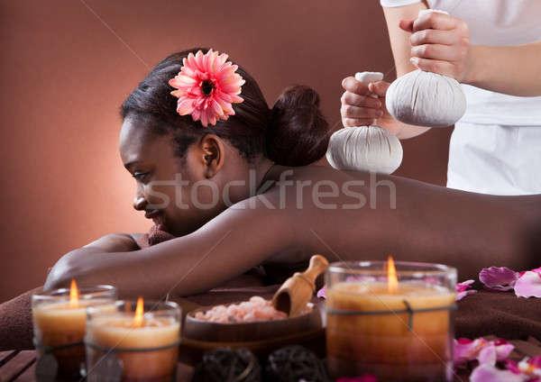 Afroamerikai nő élvezi szárított növénygyűjtemény masszázs fürdő Stock fotó © AndreyPopov
