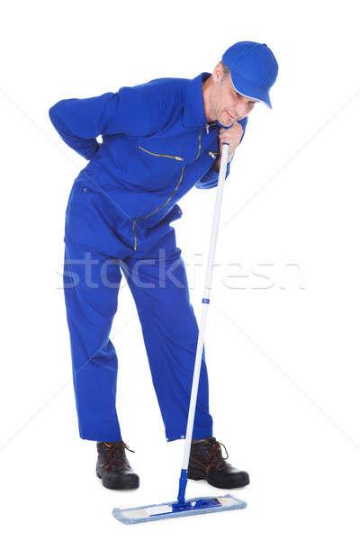 Erkek temizleyici sırt ağrısı portre üniforma Stok fotoğraf © AndreyPopov