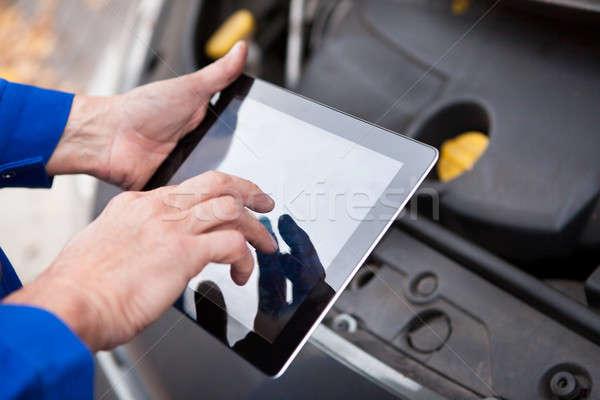 Car Mechanic Using Digital Tablet Stock photo © AndreyPopov