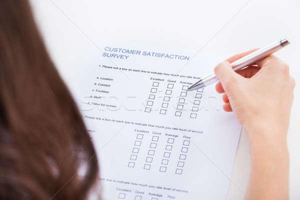Woman Filling Survey Form Stock photo © AndreyPopov