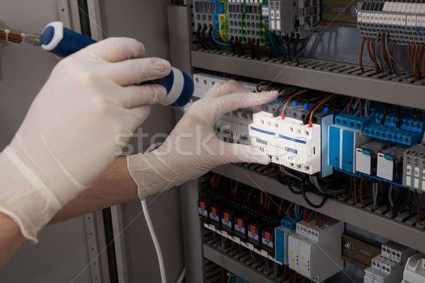 Technician Analyzing Fusebox With Flashlight Stock photo © AndreyPopov