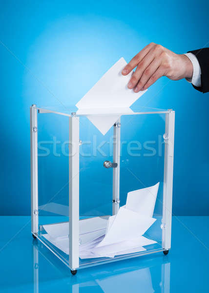 Businessman Putting Paper In Polling Box Stock photo © AndreyPopov