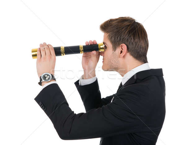 Young Businessman Looking Through Handheld Telescope Stock photo © AndreyPopov