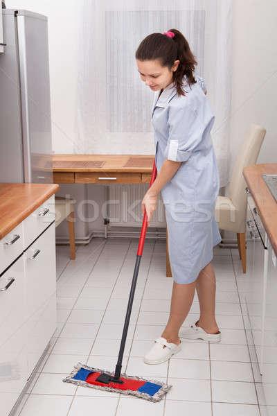 молодые горничная очистки кухне полу портрет Сток-фото © AndreyPopov