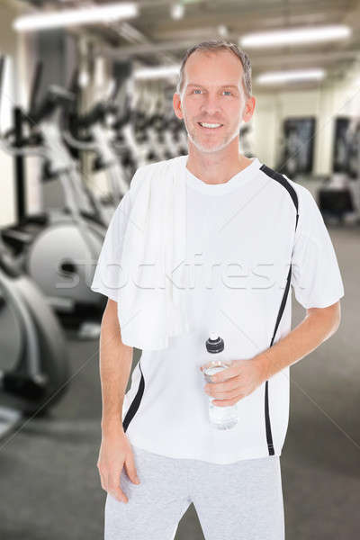 Mature Man Holding Bottle Of Water At Gym Stock photo © AndreyPopov