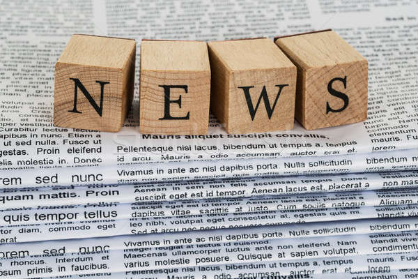 Wooden Blocks Spelling News On Newspapers Stock photo © AndreyPopov