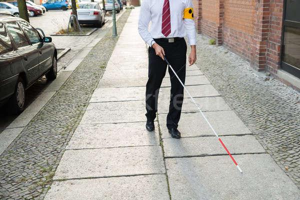 Blind Man Walking On Sidewalk Stock photo © AndreyPopov