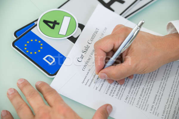 Person Filling Car Sale Contract Form Stock photo © AndreyPopov