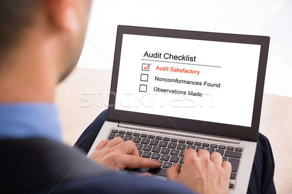 Businessman Filling Audit Checklist Form Stock photo © AndreyPopov