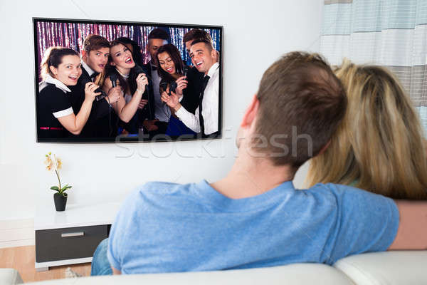 Couple Watching Television At Home Stock photo © AndreyPopov