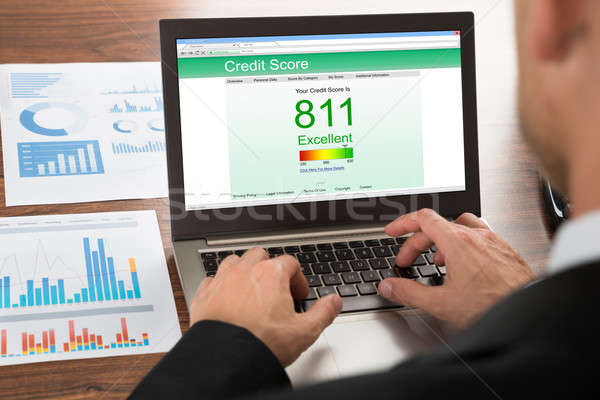 Businessman Checking Credit Score Stock photo © AndreyPopov