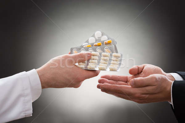 Doctor Giving Medicines To Patient Stock photo © AndreyPopov