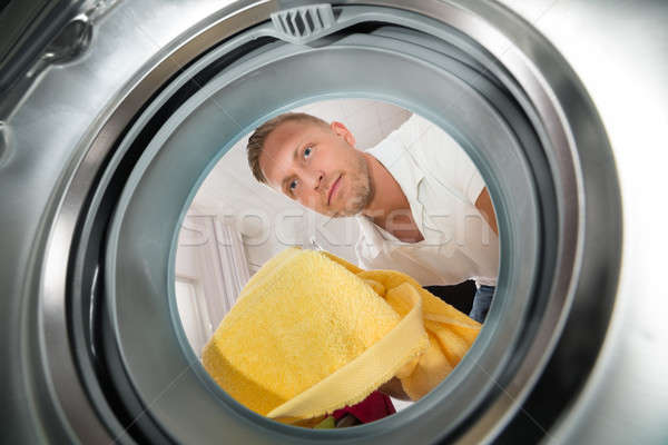 Stock photo: Man With Towel View From Inside The Washing Machine