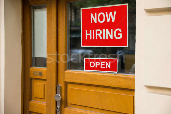 The Text Now Hiring Sticker Attached On Door Stock photo © AndreyPopov