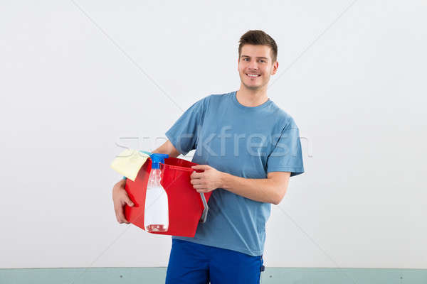 Male Janitor With Bucket And Dispenser Bottle Stock photo © AndreyPopov
