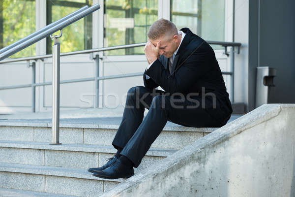 Depressief zakenman vergadering trap portret kantoor Stockfoto © AndreyPopov