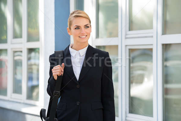Businesswoman Carrying Briefcase While Looking Away Stock photo © AndreyPopov