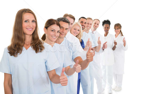 Confident Medical Team Showing Thumbs up In Line Stock photo © AndreyPopov
