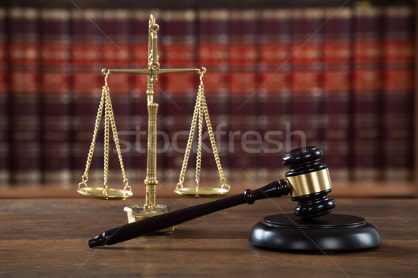 Stock photo: Mallet And Justice Scale On Table In Courtroom