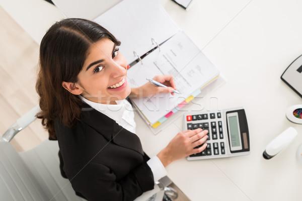 счастливым деловая женщина финансовых расчет столе непосредственно Сток-фото © AndreyPopov