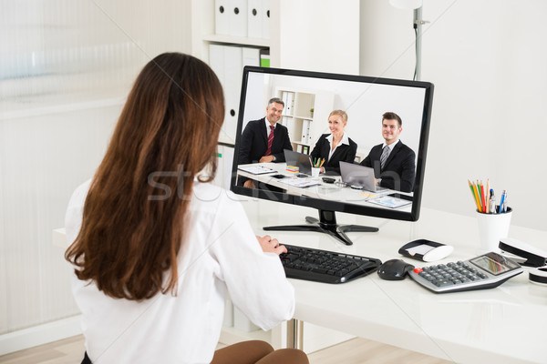 Businesswoman Attending Video Conference On Computer Stock photo © AndreyPopov