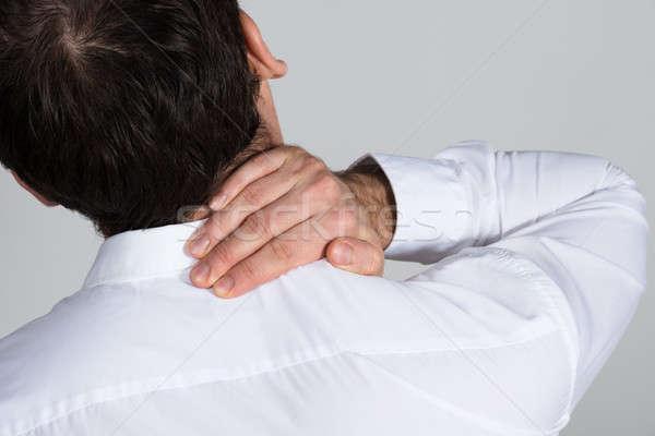 Empresário sofrimento pescoço dor branco Foto stock © AndreyPopov